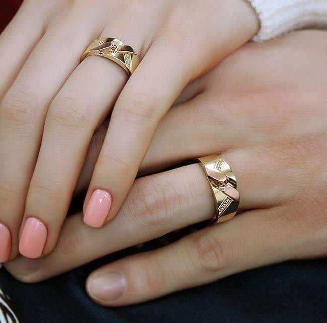 Cặp nhẫn cưới hình xếp khúc ấn tượng